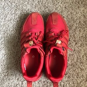 Adidas red athletic shoes